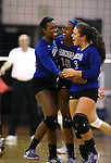 Marymount's Morgan McAlpin, Margaret McAlpin and Ashley Cabrera celebrate a point against St. Mary's during a college volleyball game in Lexington Park, MD, on Wednesday, Oct. 29, 2014. Marymount won 3-2 to go 24-9 on the season.<br /> Photo by Cathleen Allison