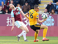 Wolverhampton Wanderers' Conor Coady vies for possession with Burnley's Ashley Barnes<br /> <br /> Photographer Rich Linley/CameraSport<br /> <br /> The Premier League - Burnley v Wolverhampton Wanderers - Saturday 30th March 2019 - Turf Moor - Burnley<br /> <br /> World Copyright © 2019 CameraSport. All rights reserved. 43 Linden Ave. Countesthorpe. Leicester. England. LE8 5PG - Tel: +44 (0) 116 277 4147 - admin@camerasport.com - www.camerasport.com