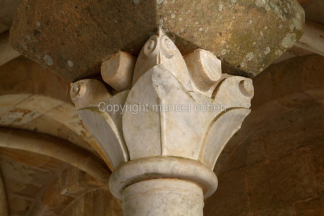 Capital with foliage carvings from the Chapter house of Fontfroide Abbey or l'Abbaye Sainte-Marie de Fontfroide, Narbonne, Languedoc-Roussillon, France. Founded by the Viscount of Narbonne in 1093, Fontfroide linked to the Cistercian order in 1145. The Chapter house was built 1180-1280 in Romanesque style, with an arcade at the entrance of 2 groups of 5 columns supporting semi-circular arches. The ceiling is vaulted with 4 supporting columns as well as pilasters around the 3 walls. There are 2 rows of benches around the walls as the Chapter house was used for meetings and religious ceremonies. Picture by Manuel Cohen