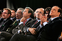 Da sinistra, il Ministro dell'Interno Roberto Maroni, il Ministro per le Riforme Umberto Bossi, il Presidente della Camera dei Deputati Gianfranco Fini, il Presidente del Senato Renato Schifani ed il Presidente del Consiglio Silvio Berlusconi in prima fila per l'apertura del congresso fondativo del PdL, partito del Popolo della Liberta', alla Nuova Fiera di Roma, 27 marzo 2009..From left, Italian Interior Minister Roberto Maroni, Reforms Minister Umberto Bossi, Lower Chamber of Deputies speaker Gianfranco Fini, Senate speaker Renato Schifani and Premier Silvio Berlusconi during the opening of the Foundation Congress of the People of Freedom center right party in Rome, 27 march 2009..UPDATE IMAGES PRESS/Riccardo De Luca