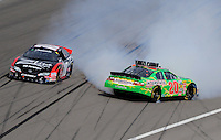 Feb. 28, 2009; Las Vegas, NV, USA; NASCAR Nationwide Series driver Denny Hamlin (20) spins alongside teammate Kyle Busch (18) during the Sam's Town 300 at Las Vegas Motor Speedway. Mandatory Credit: Mark J. Rebilas-