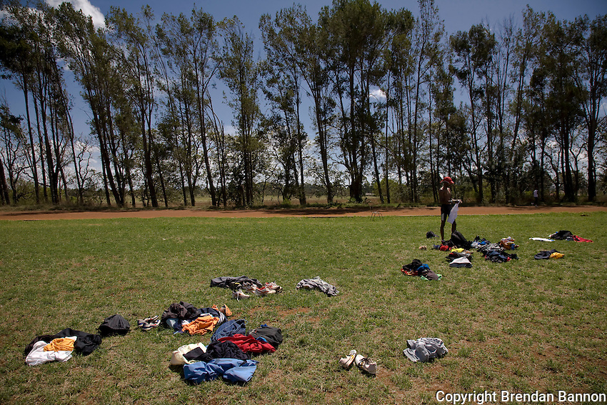 Mo Farah prepares for  a work out at the Moi University training track. Untested amatuers train alongside professional runners like Mr. Farah, a  European champion. The track is near Eldoret, Kenya.