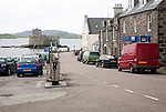 Main shopping street in Castlebay the largest settlement in Barra, Outer Hebrides, Scotland, UK looking to Kisimul castle