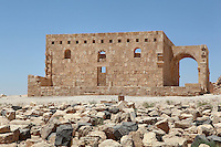 Qasr al Hallabat, an Umayyad palace complex built on the site of a Roman fortress by Hisham ibn Abd al-Malik, Jordan. The complex includes a mosque, water system and reservoir, irrigated agricultural land and the palace. The nearby bathhouse Hammam as Sarah served this desert castle. The building was originally decorated with mosaics, frescoes and stucco carvings. Picture by Manuel Cohen