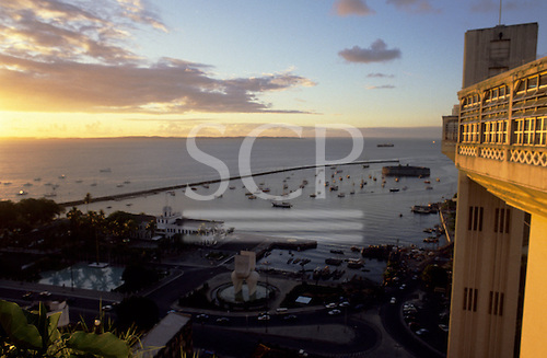 Salvador, Bahia, Brazil. View of the harbour bay from Lacerda elevator, at sunset.