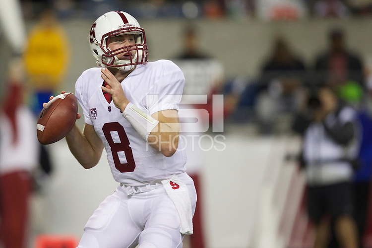 Stanford quarterback Kevin Hogan drops back to pass during play against Washington State at CenturyLink Field in Seattle Saturday September 28, 2013.