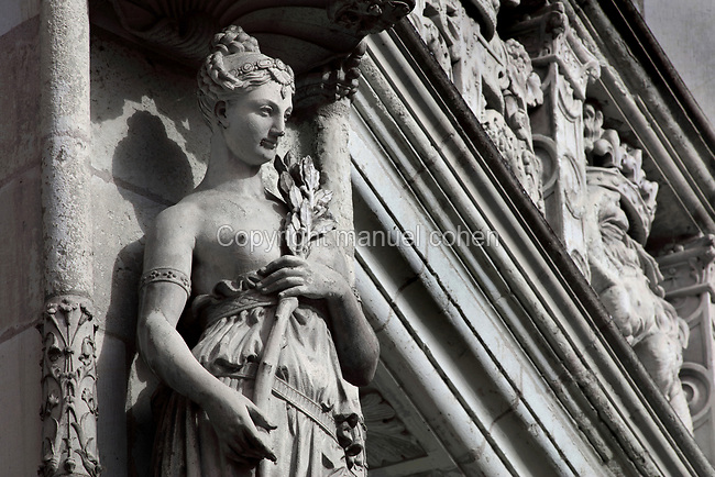 Statue of a classical female figure holding an olive branch, sculptural detail from the monumental spiral staircase, 16th century, French School, on the interior South East facade of the Francois I wing, in Renaissance style, at the Chateau Royal de Blois, built 13th - 17th century in Blois in the Loire Valley, Loir-et-Cher, Centre, France. The staircase is covered in bas-relief sculptures and looks onto the courtyard of the chateau. The chateau has 564 rooms and 75 staircases and is listed as a historic monument and UNESCO World Heritage Site. Picture by Manuel Cohen