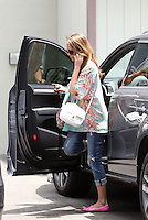 Jessica Alba wore a beautiful summerly floral print blouse with a white cross body bag, distressed jeans and pink flats while out running some errands. Los Angeles, California on 11.6.2012..Credit: Correa/face to face.. /MediaPunch Inc. ***FOR USA ONLY*** NORTEPHOTO.COM<br />