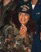 Downtown Julie Brown pauses to enjoy the Christmas USO Show hosted by United States Secretary of Defense William S. Cohen (not pictured) aboard the landing helicopter dock ship USS Bataan (LHD 5) on December 21, 1999. Cohen's stop aboard Bataan was the first of several visits to military units operating through southern Europe and the Balkans during the Christmas and New Year's holiday season.  .Mandatory Credit: Dewitt D. Roseborough / U.S. Navy via CNP          .
