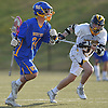 Conor Smith #24 of West Islip, left, gets pressured by Vincent Deceglia #27 of Northport during a Suffolk County varsity boys lacrosse game at Veterans Park in East Northport on Monday, Apr. 18, 2016. Smith tallied five goals, including two in the final minute of play, to lead West Islip to a 10-9 victory.