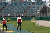 11th March 2020; Albert Park, Melbourne, Australia; Formula 1 Australia Grand Prix, setup day; Alfa Romeo Racing Orlen, Antonio Giovinazzi walks the track and checks out the surface of the astroturf