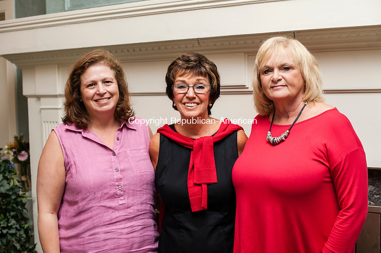 BRISTOL, CT-8 August 2014-080814EC04-  Social Moments. From L to R: Theresa DiGiovanni, president of the board at Safe Haven, Peggy Panagrossi, executive director of Safe Haven, and Deb Skinner, secretary of the Safe Haven board. The 24th annual Safe Haven Golf Tournament was presented by Naugatuck Valley Savings and Loan at the Chippanee Golf Club in Bristol. Erin Covey Republican-American