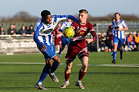 Jonathan Nzengo of Aveley and Tom Knowles of Chelmsford City during Aveley vs Chelmsford City, Buildbase FA Trophy Football at Parkside on 8th February 2020