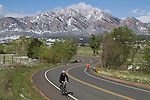 Woman biking and man running in Boulder, Colorado, USA.