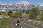 Woman biking and man running in Boulder, Colorado, USA.