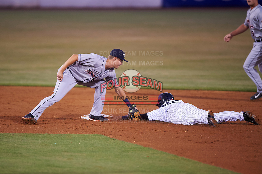 Lakeland Flying Tigers shortstop A.J. Simcox (1) applies the tag to Abiatal Avelino (22) sliding into second during a game against the Tampa Yankees on April 8, 2016 at George M. Steinbrenner Field in Tampa, Florida.  Tampa defeated Lakeland 7-1.  (Mike Janes/Four Seam Images)