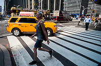 Taxis go about their business on Sixth Avenue in New York on Thursday, September 3, 2015. Because of the rise in Uber and other apps taxi medallions have decreased in worth to about $900,000 with loan delinquencies on the rise. The Melrose Credit Union has $168 million in delinquencies as of May 2015 while in January 2014 it had only $32,000. In the next six months Melrose has $212 million in maturing loans which many owners will be unable to pay.   (© Richard B. Levine)