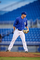 Dunedin Blue Jays relief pitcher Jonathan Cheshire (18) looks in for the sign during a game against the Jupiter Hammerheads on August 14, 2018 at Dunedin Stadium in Dunedin, Florida.  Jupiter defeated Dunedin 5-4 in 10 innings.  (Mike Janes/Four Seam Images)