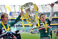 Matthew Tait and Toby Flood lift the Aviva Premiership trophy in celebration. Aviva Premiership Final, between Leicester Tigers and Northampton Saints on May 25, 2013 at Twickenham Stadium in London, England. Photo by: Patrick Khachfe / Onside Images