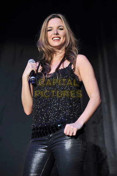 WONDERLAND - Jodi Albert.Performing live at Wembley Arena, London, England..February 26th, 2011.stage concert live gig performance music hlaf length black leggings sleeveless top leather .CAP/MAR.© Martin Harris/Capital Pictures.