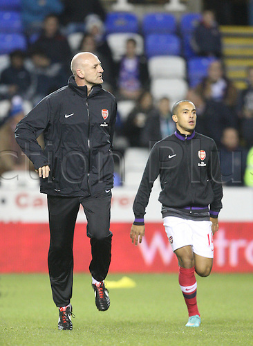 17.12.2012. Reading, England. Steve Bould Assistant Manager of Arsenal with Theo Walcott of Arsenal before the kick off of the Premier League match between Reading and Arsenal from the Madejski Stadium.