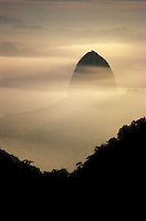 Rio's famous Sugarloaf mountain towers up through a misty sunrise. The city of nine million boasts the world's largest urban forest — the Floresta da Tijuca.