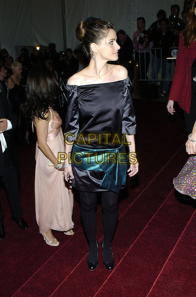"AMANDA PEET  .2007 Metropolitan Museum of Art Costume Institute Gala celebrating ""Poiret: King of Fashion"" exibition at the Metropolitan Museum of Art, New York City, New York, USA. .May 7th, 2007.full length black off the shoulder dress blue green turquoise bow waist profile .CAP/ADM/BL.©Bill Lyons/AdMedia/Capital Pictures *** Local Caption ***"