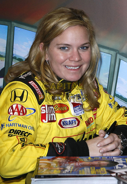 SARAH FISHER.2009 Consumer Electronics Show held at the Las Vegas Convention Center, Las Vegas, Nevada, USA..January 8th, 2009.half length top jacket yellow .CAP/ADM/MJT.© MJT/AdMedia/Capital Pictures.