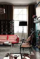 In the living room the 1960s Danish sofa was given a fresh appearance with with fabric by New Zealand based Mokum and the late 19th century chair is covered with stripy fabric by Donghia. The black lacquered room divider is designed by Pitfield London.