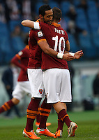 Calcio, Serie A: Roma-Genoa. Roma, stadio Olimpico, 12 gennaio 2014.<br /> AS Roma defender Mehdi Benatia, of Morocco, celebrates with teammate Francesco Totti, right, after scoring during the Italian Serie A football match between AS Roma and Genoa, at Rome's Olympic stadium, 12 January 2014. <br /> UPDATE IMAGES PRESS/Riccardo De Luca