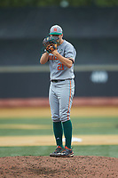 Miami Hurricanes starting pitcher Slade Cecconi (21) looks to his catcher for the sign against the Wake Forest Demon Deacons at David F. Couch Ballpark on May 11, 2019 in  Winston-Salem, North Carolina. The Hurricanes defeated the Demon Deacons 8-4. (Brian Westerholt/Four Seam Images)