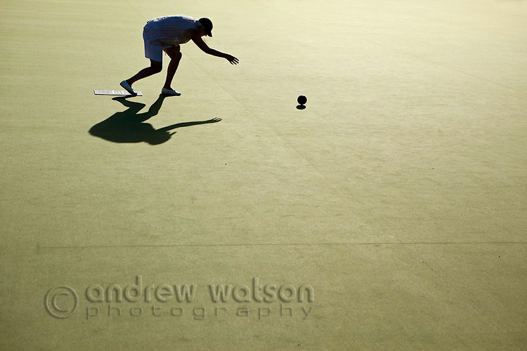 Woman playing lawn bowls.  Cooktown, Queensland, Australia