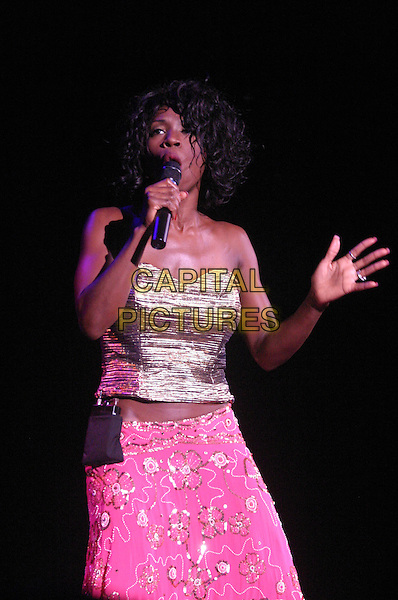 HEATHER SMALL .M People .plays Nottingham Arena..UK, United Kingdom..Ref: JEZ.30th September 2005.half length M People live on stage performing gig sing singing mpeople m-people holding microphone pastel pink strapless boobtube silk satin bright sequinned skirt.www.capitalpictures.com.sales@capitalpictures.com.©Capital Pictures.