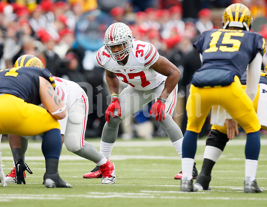 Ohio State Buckeyes linebacker Joshua Perry (37) against Michigan Wolverines at Michigan Stadium in Arbor, Michigan on November 28, 2015.  (Dispatch photo by Kyle Robertson)