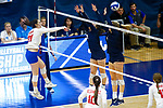 PENSACOLA, FL - DECEMBER 09: Anna Tovo (21) of Florida Southern College spikes the ball past Elizabeth Mohr (13) and Shelby Seurer (4) of Concordia University, St. Paul during the Division II Women's Volleyball Championship held at UWF Field House on December 9, 2017 in Pensacola, Florida. (Photo by Timothy Nwachukwu/NCAA Photos via Getty Images)