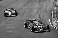 EAST RUTHERFORD, NJ - JUNE 30: Bobby Rahal drives the Budweiser March 85C/Cosworth ahead of Al Unser, Jr. in the Domino's Lola T900/Cosworth during the Meadowlands U.S. Grand Prix CART IndyCar race at the Meadowlands Sports Complex in East Rutherford, New Jersey, on June 30, 1985.