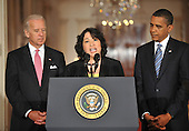 Washington, D.C. - May 26, 2009 -- Judge Sonia Sotomayor of the Federal Appeals Court , center, makes remarks after United States President Barack Obama, right, named her as his nominee for Justice of the U.S. Supreme Court in the East Room of the White House on Tuesday, May 26, 2009.  She will replace retiring Justice David Souter. Judge Sotomayor, 54, of The Bronx, New York, will be the first Hispanic to serve if her nomination is approved by the U.S. Senate.  Vice President Joseph Biden looks on from the left..Credit: Ron Sachs / Pool via CNP