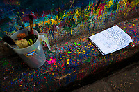 """Clean brushes and a poster sketch are seen placed on a splattered kerb in the sign painting workshop in Cartagena, Colombia, 12 December 2017. Hidden in the dark, narrow alleys of Bazurto market, a group of dozen young men gathered around José Corredor (""""Runner""""), the master painter, produce every day hundreds of hand-painted posters. Although the vast majority of the production is designed for a cheap visual promotion of popular Champeta music parties, held every weekend around the city, Runner and his apprentices also create other graphic design artworks, based on brush lettering technique. Using simple brushes and bright paints, the artisanal workshop keeps the traditional sign painting art alive."""
