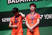 15th March 2020, Arena Birmingham, Birmingham, UK;  Chinas Du Yue L and Li Yinhui at the trophy presentation ceremony after losing the womens doubles final match against Japans Fukushima Yuki and Hirota Sayaka at All England Open 2020 badminton tournament in Birmingham
