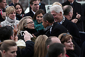 United States President Barack Obama greets U.S. Secretary of State Hillary Rodham Clinton and former U.S. President Bill Clinton during the presidential inauguration on the West Front of the U.S. Capitol January 21, 2013 in Washington, DC.   Barack Obama was re-elected for a second term as President of the United States.    .Credit: Win McNamee / Pool via CNP