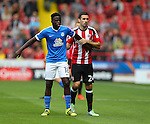 Danny Lafferty of Sheffield Utd marks Leo Da-Silva-Lopes of Peterborough Utd  during the League One match at Bramall Lane Stadium, Sheffield. Picture date: September 17th, 2016. Pic Simon Bellis/Sportimage