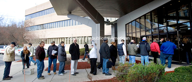 MIDDLETOWN CT. 30 December 2013-123013SV05-Owners of assault weapons and high capacity magazines wait in line to register them at the Department of Emergency Services and Public Protection Special Licensing and Firearms in Middletown Monday. <br /> Steven Valenti Republican-American