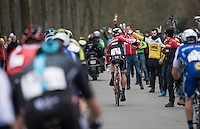 last years winner (#1) Jasper Stuyven (BEL/Trek-Segafredo) catching a bidon at high speed<br /> <br /> 69th Kuurne-Brussel-Kuurne 2017 (1.HC)
