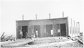 4-stall brick roundhouse under construction.  View from across turntable.<br /> Canon City, CO  Taken by Dennis, A. W.