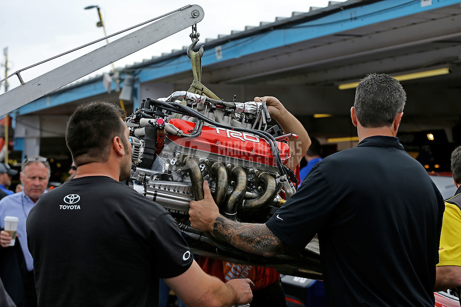 Mar. 3, 2013; Avondale, AZ, USA; Crew members change engines in the car of NASCAR Sprint Cup Series driver Kyle Busch in the garage prior to the Subway Fresh Fit 500 at Phoenix International Raceway. Mandatory Credit: Mark J. Rebilas-