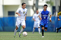 2 October 2011:  FIU midfielder/forward Mario Uribe (17) moves the ball upfield while being pursued by Kentucky defender Charlie Pettys (21) in the second half as the FIU Golden Panthers defeated the University of Kentucky Wildcats, 1-0 in overtime, at University Park Stadium in Miami, Florida.