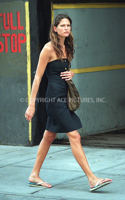 ***EXCLUSIVE***..Top model FRANKIE RYDER dressed in casual black tube dress and flip-flops as she takes an afternoon stroll in SoHo. New York, June 28, 2002.  Please byline: Alecsey Boldeskul/NY Photo Press.   ..*PAY-PER-USE*      ....NY Photo Press:  ..phone (646) 267-6913;   ..e-mail: info@nyphotopress.com