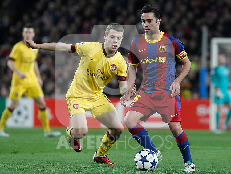 FC Barcelona's Xavi Hernandez (r) and Arsenal's Jack Wilshere during UEFA Champions League match.March 8,2011. (ALTERPHOTOS/Acero)