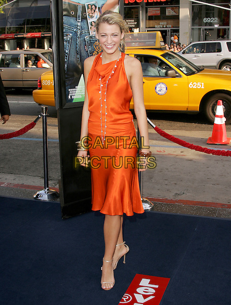 "BLAKE LIVELY.attends Warner Brother Pictures' World Premiere of ""The Sisterhood of The Traveling Pants"" held at Grauman's Chinese Theatre in Hollywood, California, USA,.May 31st 2005.full length orange dress gold bangles bracelets necklace beads.Ref: DVS.www.capitalpictures.com.sales@capitalpictures.com.©Debbie VanStory/Capital Pictures"