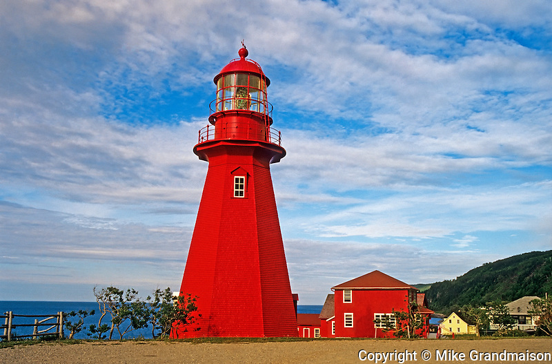 Red lighthouse and lightkeeper's house on Gaspe Peninsula<br /> La Martre<br /> Quebec<br /> Canada
